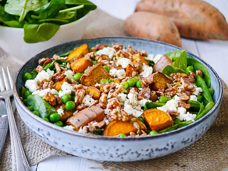 Sweet Potato, Pea and Feta Salad. A bed of leafy greens topped with roasted chunks of sweet potato, bright peas and creamy feta. Gluten free and grain free
