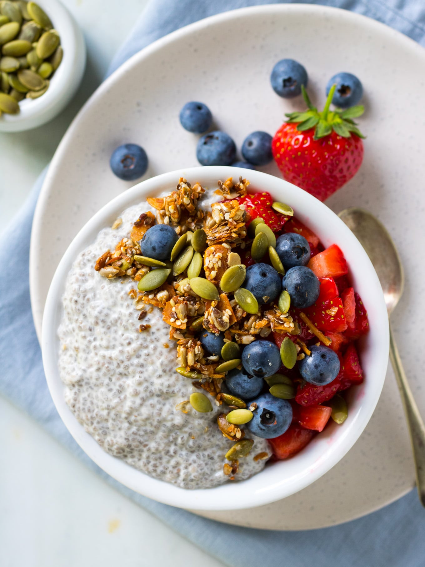 Vanilla Chia Pudding made with coconut milk, vanilla and maple syrup. Serve with fruit and granola for a #healthy breakfast! #chiapudding #dairyfree #breakfast