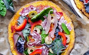 A healthy paleo pumpkin pizza crust recipe using mashed pumpkin, almond flour and psyllium husk. It's grain free and dairy free, and can be made vegan using a flax egg!