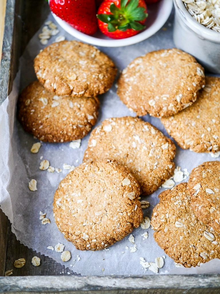 This easy buckwheat ANZAC biscuits recipe is wheat free, dairy free and nut free. A simple vegan biscuit with that classic combo of oats and coconut! Recipe by Nourish Every Day
