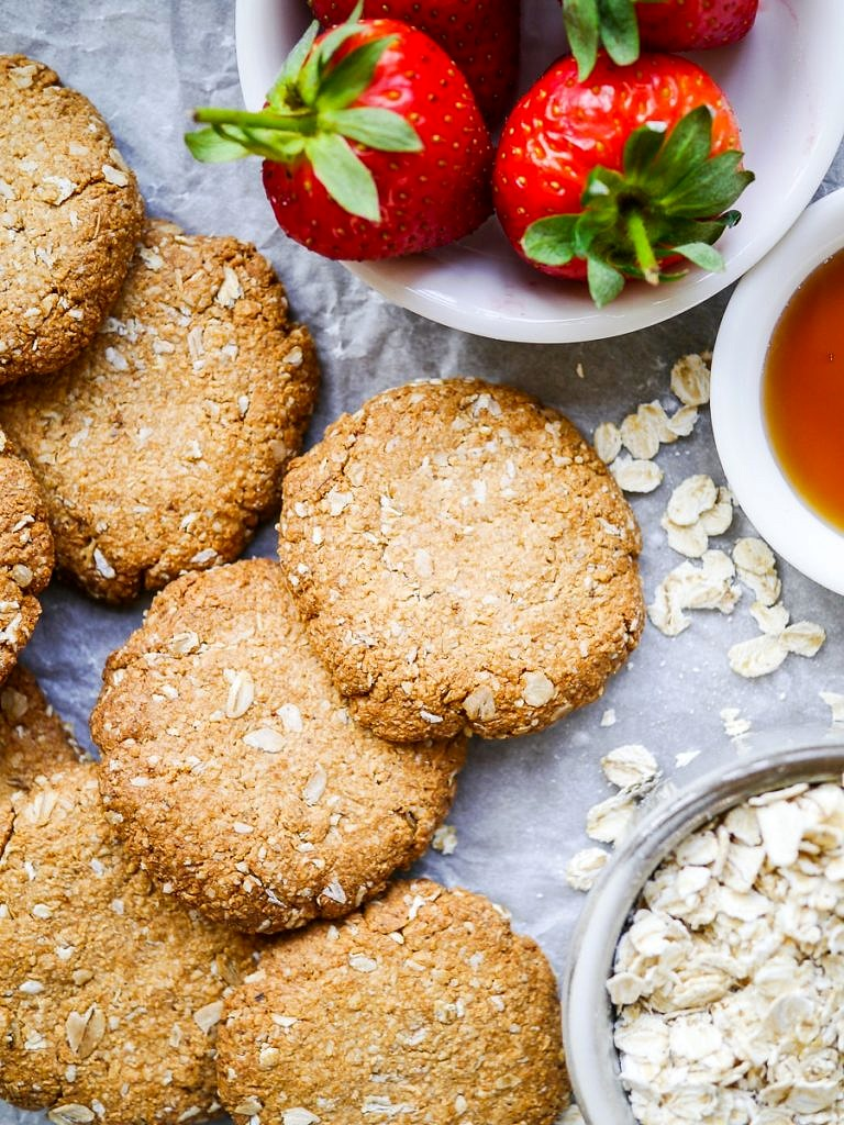 This easy buckwheat ANZAC biscuits recipe is wheat free, dairy free and nut free, plus gluten free if you have gluten free oats. A simple vegan biscuit with that classic combo of oats and coconut! Recipe by Nourish Every Day