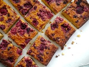 Orange, Almond and Raspberry Cake - gluten free, grain free, dairy free - it's paleo friendly! Recipe via Nourish Everyday
