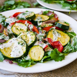 Roasted Zucchini Salad with Yoghurt Dill Dressing - This healthy roasted zucchini salad recipe is quick and easy to prepare. Gluten free & grain free, topped with a creamy yoghurt-dill dressing! Recipe via wordpress-6440-15949-223058.cloudwaysapps.com
