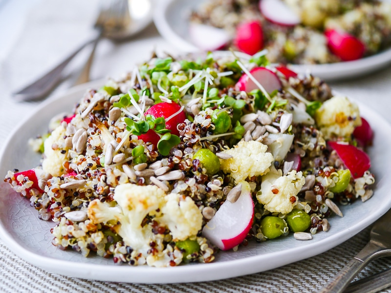This gorgeous pea and cauliflower quinoa pilaf is packed full of healthy vegetables. Vegan, gluten free and sugar free. The perfect side dish!