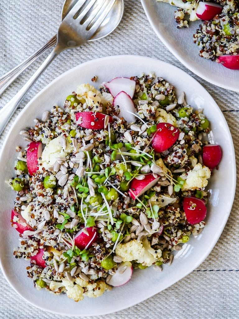 This gorgeous pea and cauliflower quinoa pilaf is full of nourishing vegetables. Vegan, gluten free and sugar free. It makes a great side dish and is also perfect for packing for a healthy lunch!