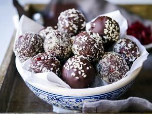 Cranberry and date chocolate truffles are a dreamy dairy free, gluten free treat. Nuts and coconut flour create a healthy spin on a chocolate truffle! Recipe via nourisheveryday.com