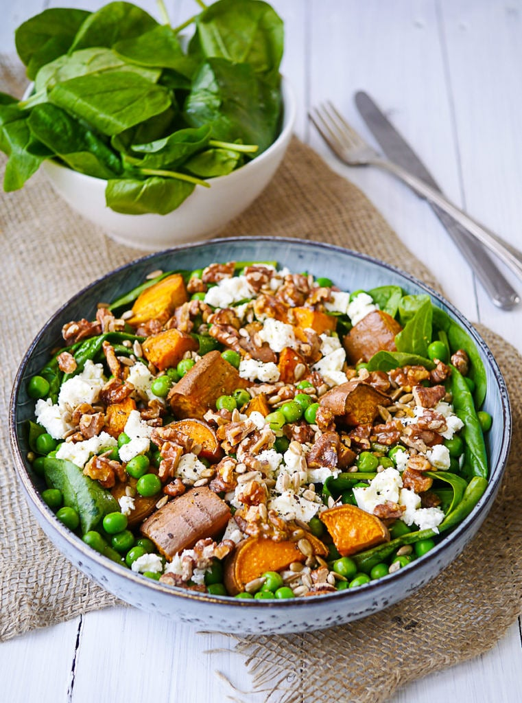 Sweet Potato, Pea and Feta Salad. A bed of leafy greens topped with roasted chunks of sweet potato, bright peas and creamy feta. Gluten free and grain free.