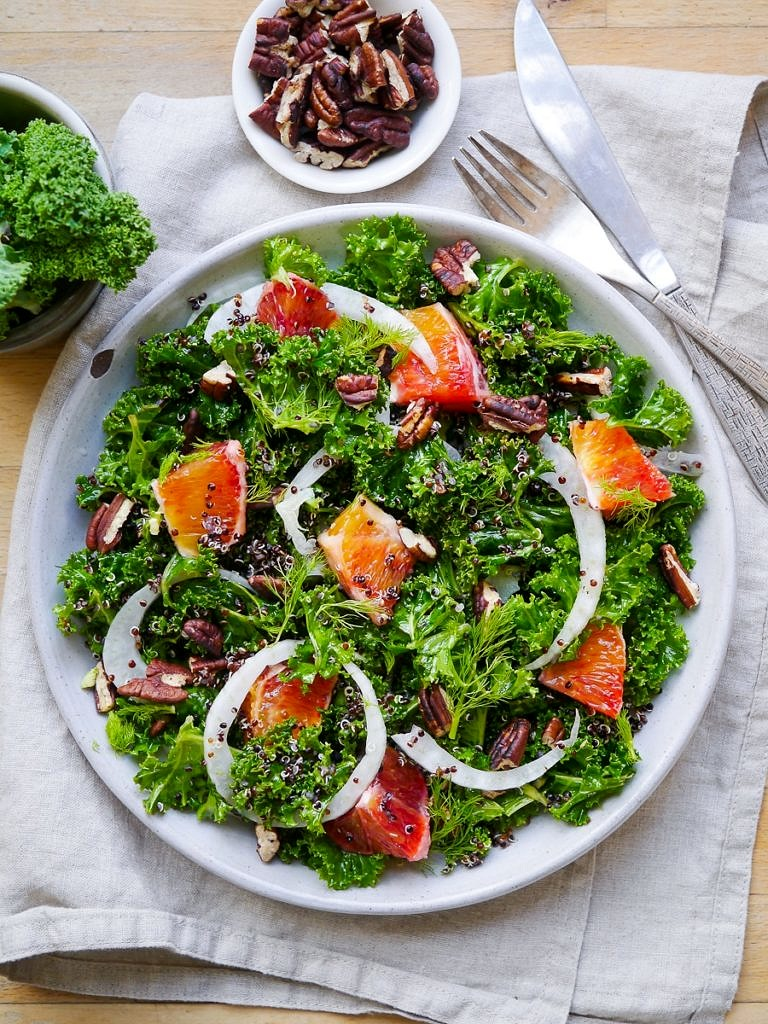 A vibrant, healthy massaged kale and blood orange salad. Finished with crunchy pecans! Gluten free, dairy free and vegan friendly. Recipe via nourisheveryday.com