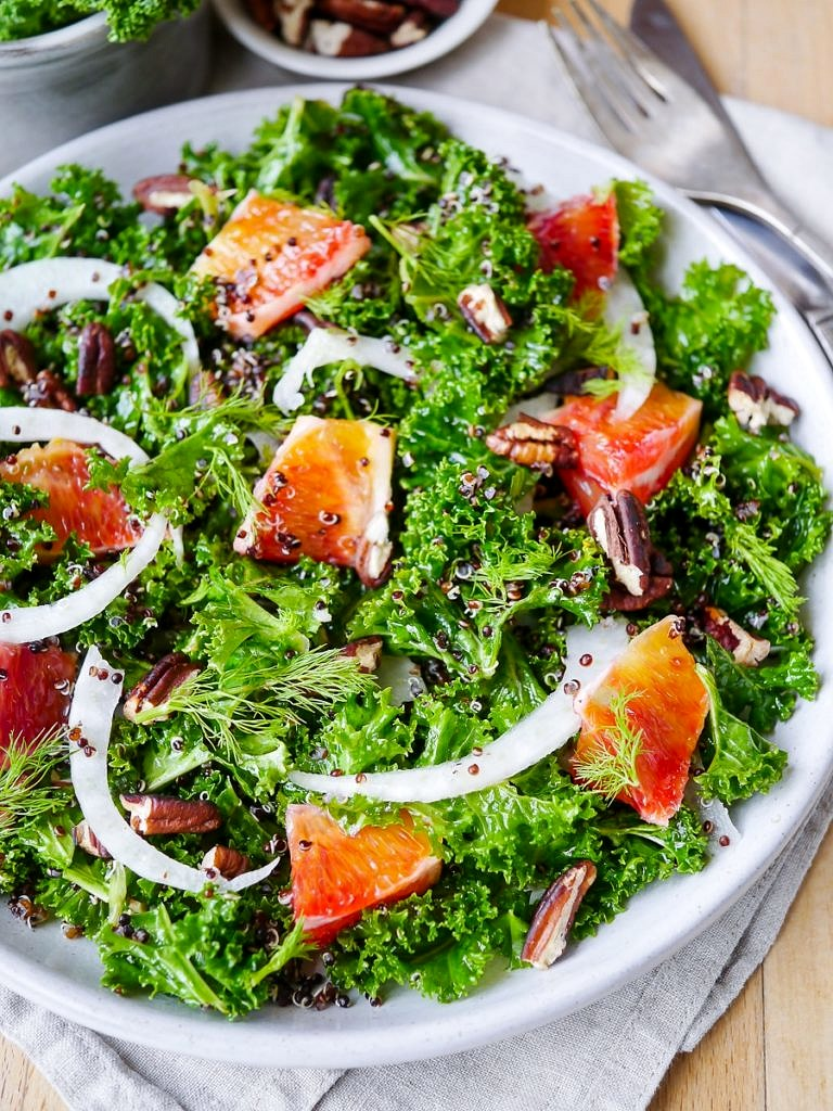 A vibrant, healthy massaged kale and blood orange salad. Finished with crunchy pecans! Gluten free, dairy free and vegan friendly