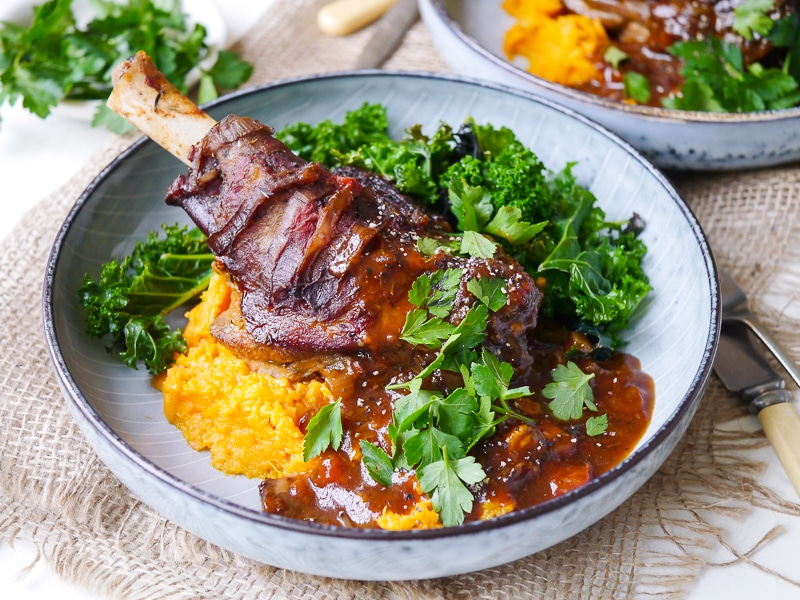My Most Popular Recipes in 2017: Thyme and Balsamic Slow Cooker Lamb Shanks in a rich flavoursome tomato sauce. Gluten free, dairy free and really easy to make!