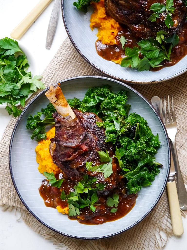 Balsamic slow cooker lamb shanks made with dried thyme and a rich tomato sauce. Tastes luxurious but healthy! Gluten free, dairy free and really easy to make!