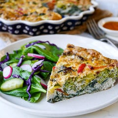 This pesto vegetable frittata makes an easy, healthy meal that can be made ahead of time. Gluten free and grain free, a simple delicious way to get in your veggies! Recipe by Nourish Everyday