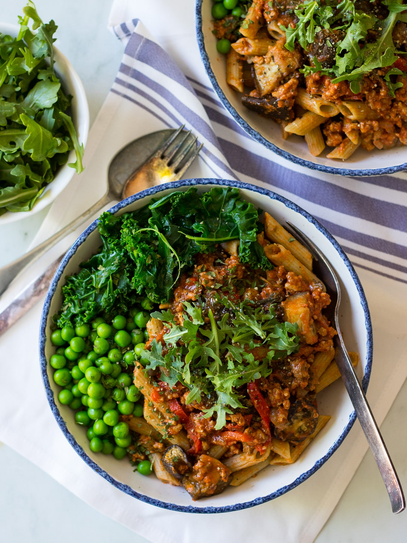 Roast Eggplant and Kale Bolognese - a healthy bolognese sauce made gluten free and dairy free. Freezes well and easy! Served over gluten free legume pasta, you could also make this paleo and use zoodles. #healthybolognese #glutenfreepasta