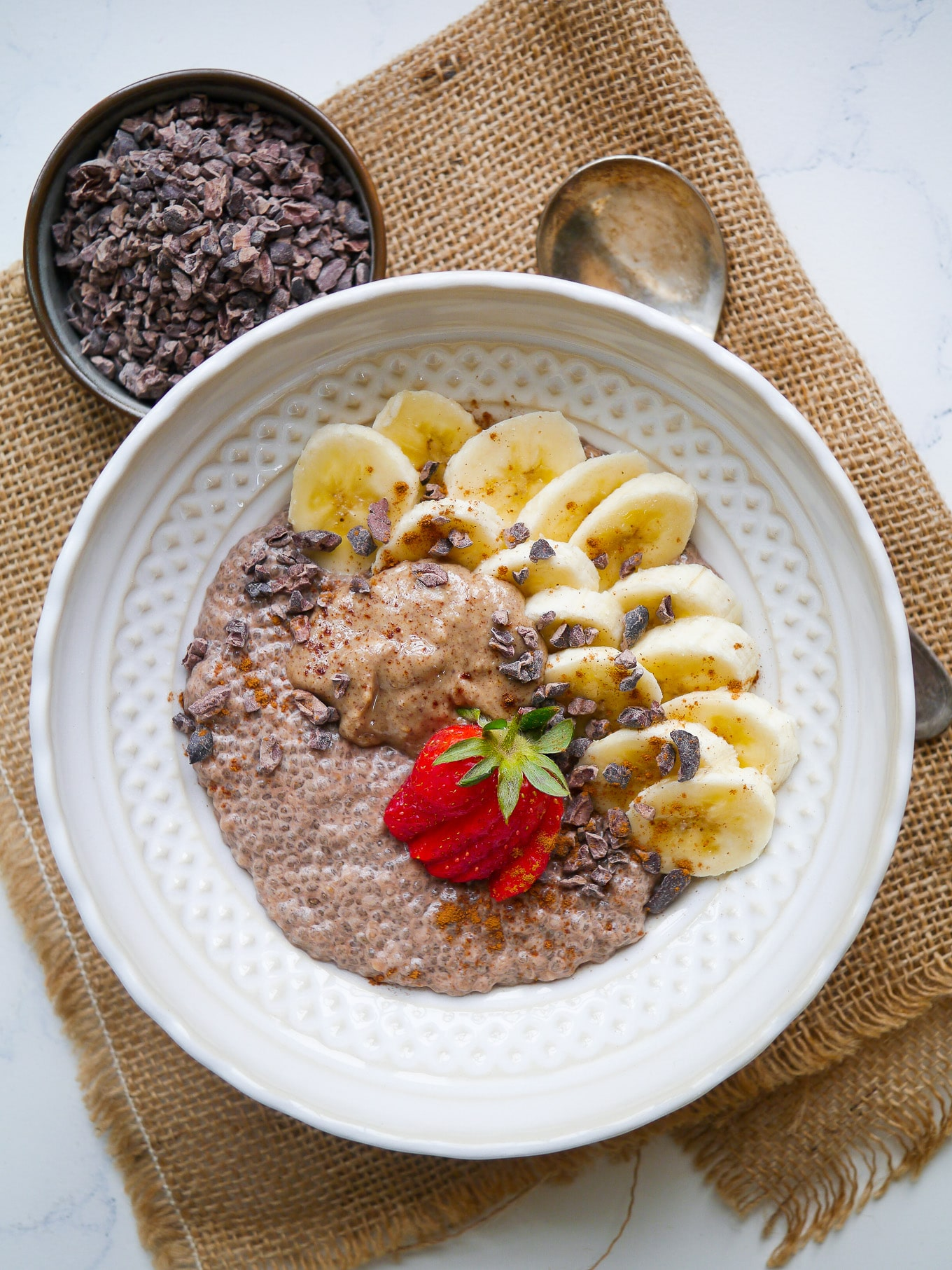 Easy chunky monkey chia pudding is a great healthy breakfast or snack; maybe even dessert! Cacao chia base, sweet banana, creamy peanut butter and crunchy cacao nibs. Gluten free, dairy free and grain free.
