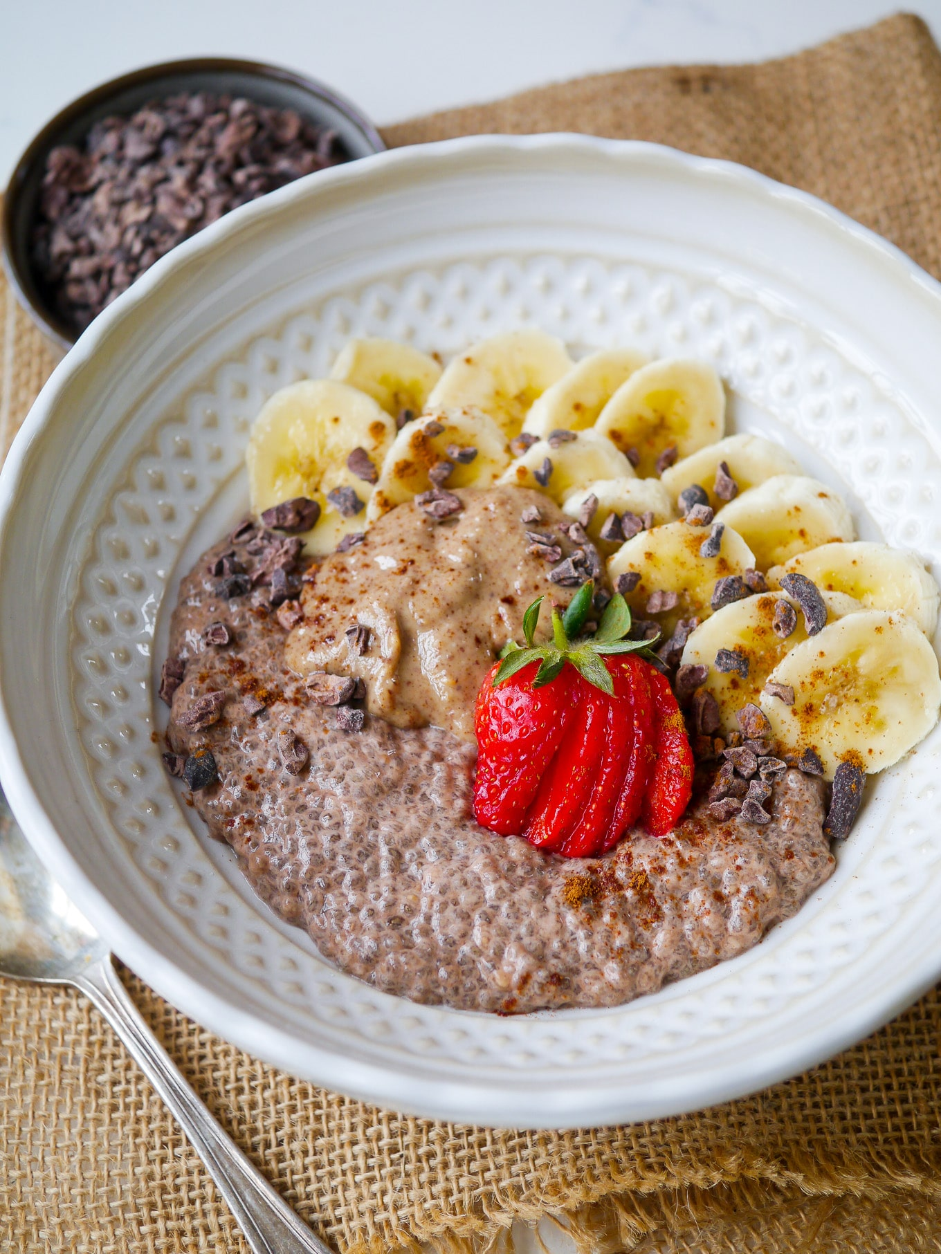 Easy Chunky Monkey Chia Pudding - cacao chia pudding made with creamy nut milk and served with sliced banana, peanut butter and cacao nibs. Yum! #glutenfree #dairyfree #chiapudding