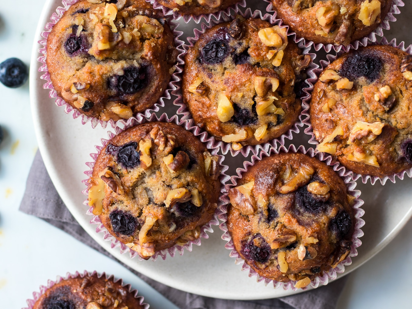 Healthy Blueberry Cinnamon Muffins on white plate