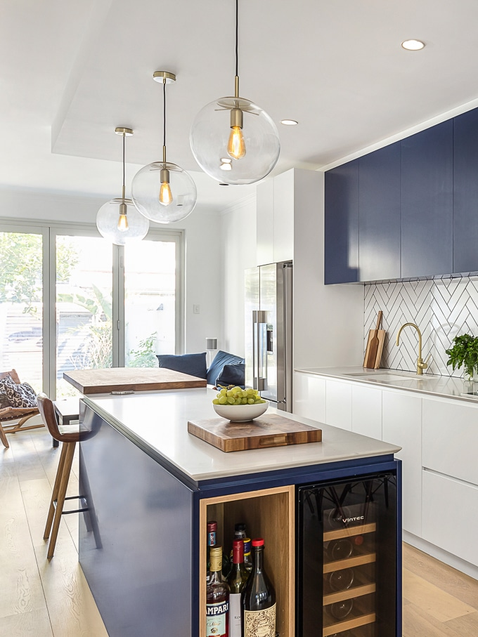 Terrace kitchen renovation (white and navy cabinets, subway tiles, kitchen island)