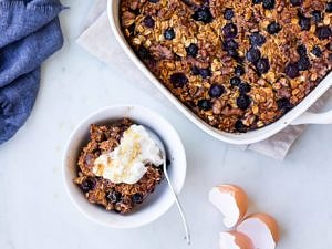 coconut blueberry baked oats with Greek yoghurt dish and serving bowl
