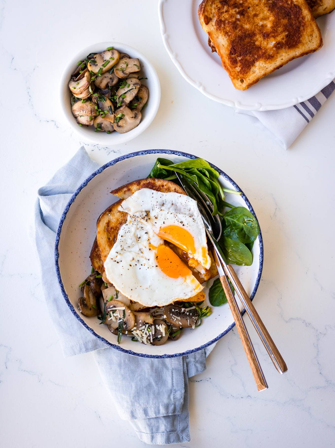 Savoury french toast with mushrooms, parmesan and a fried egg on top