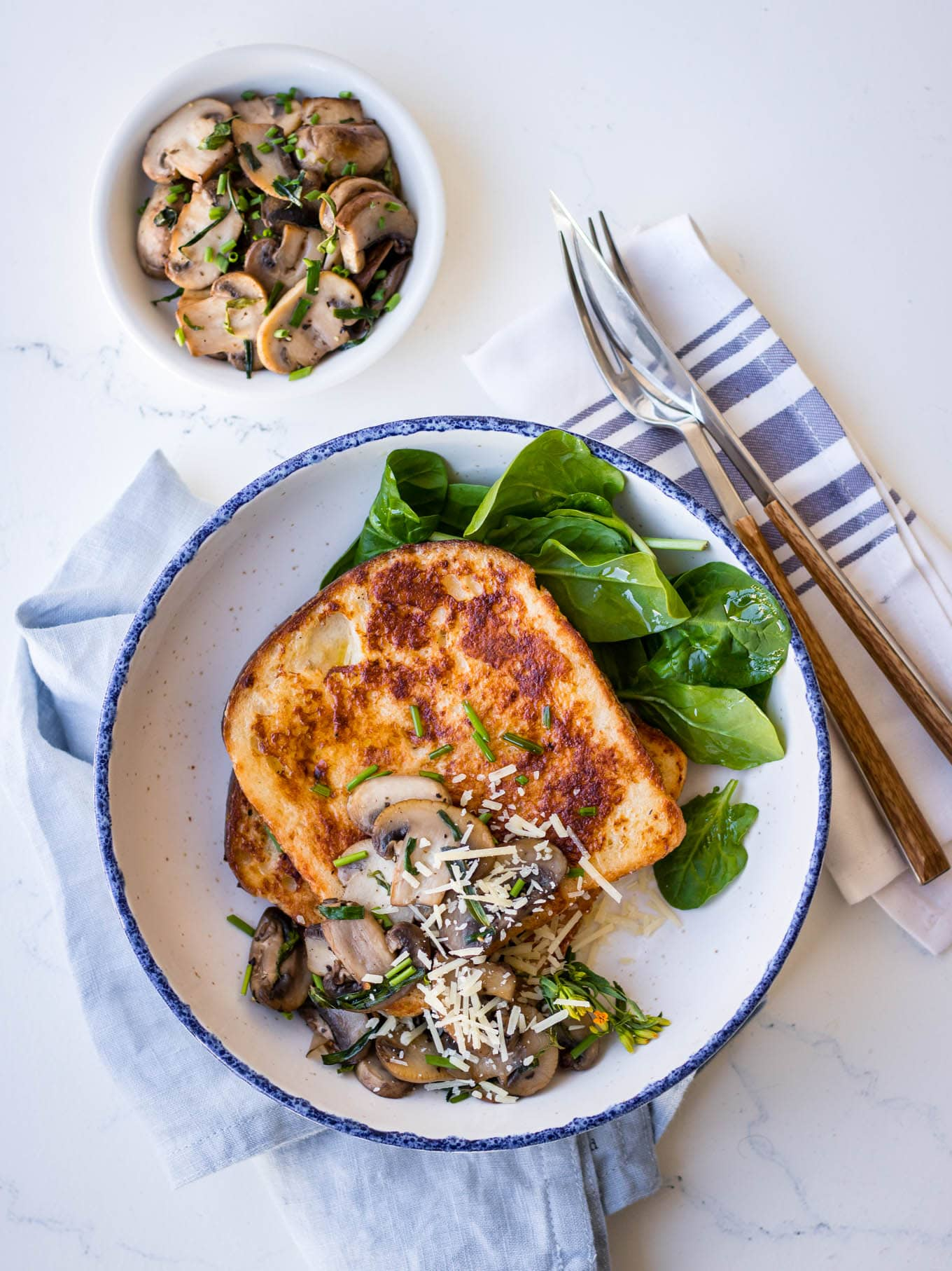 Savoury french toast with mushrooms and grated parmesan