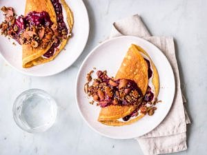 Sweet cinnamon omelettes with berry compote and granola topping