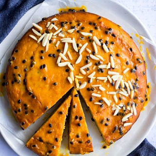 passionfruit yoghurt cake with passionfruit glaze and almonds