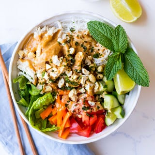 vermicelli noodle bowl with peanut butter sauce, poached chicken and fresh vegetables