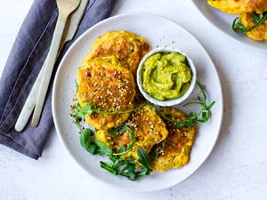 Gluten Free Corn Fritters arranged with rocket on grey ceramic plate | Nourish Every Day Blog
