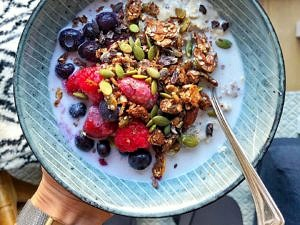 Granola bowl with fruit and fortified plant milk by Nourish Every Day