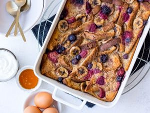 Baked French Toast topped with berries and banana slices