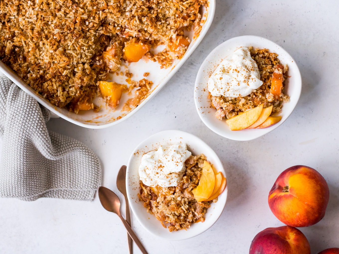Gluten free nectarine crumble topped with yoghurt and cinnamon