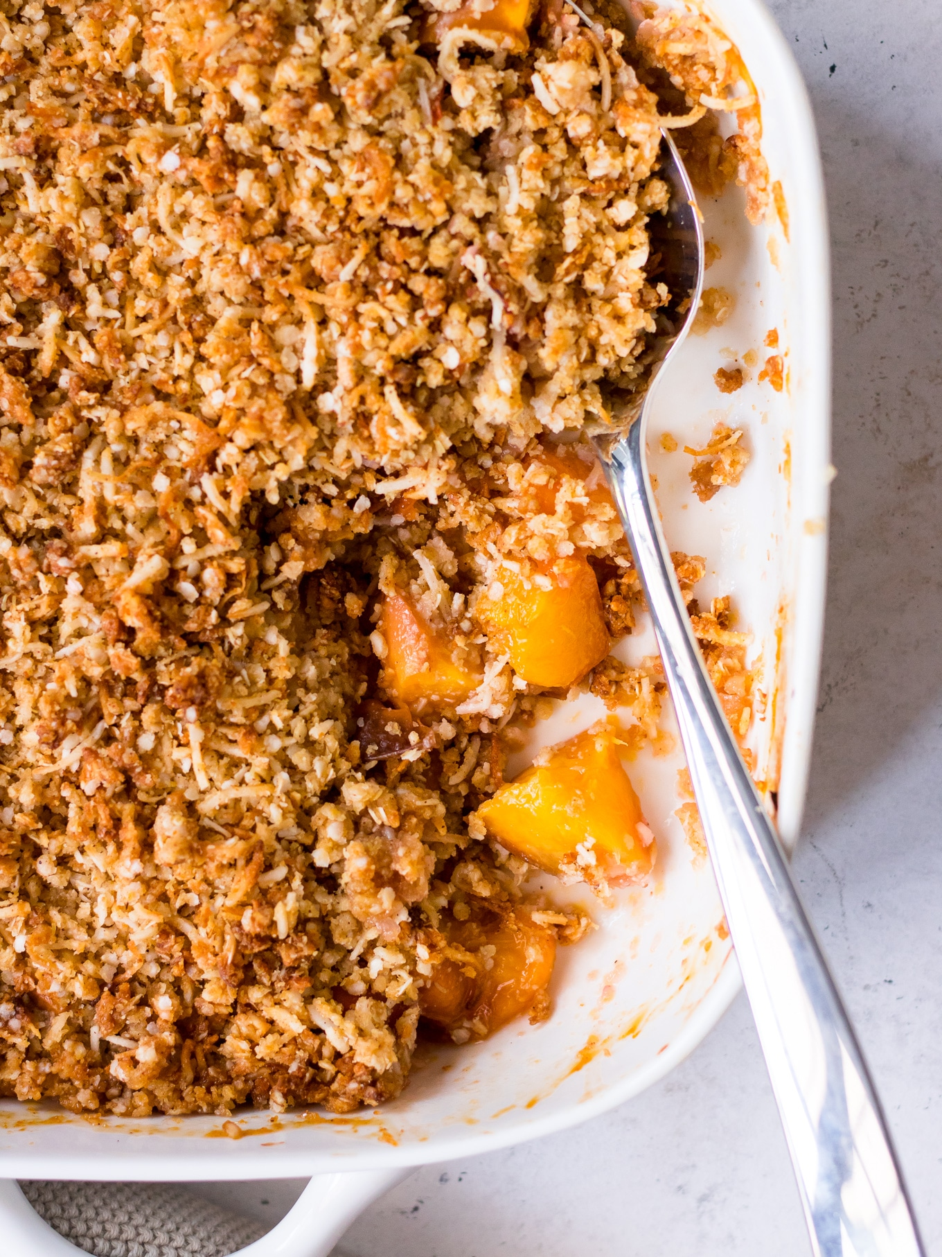 Close up of gluten free crumble topping made with quinoa flakes and coconut