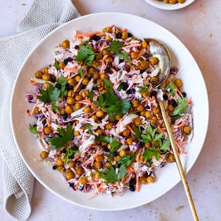 Healthy yoghurt coleslaw topped with roasted chickpeas main shot