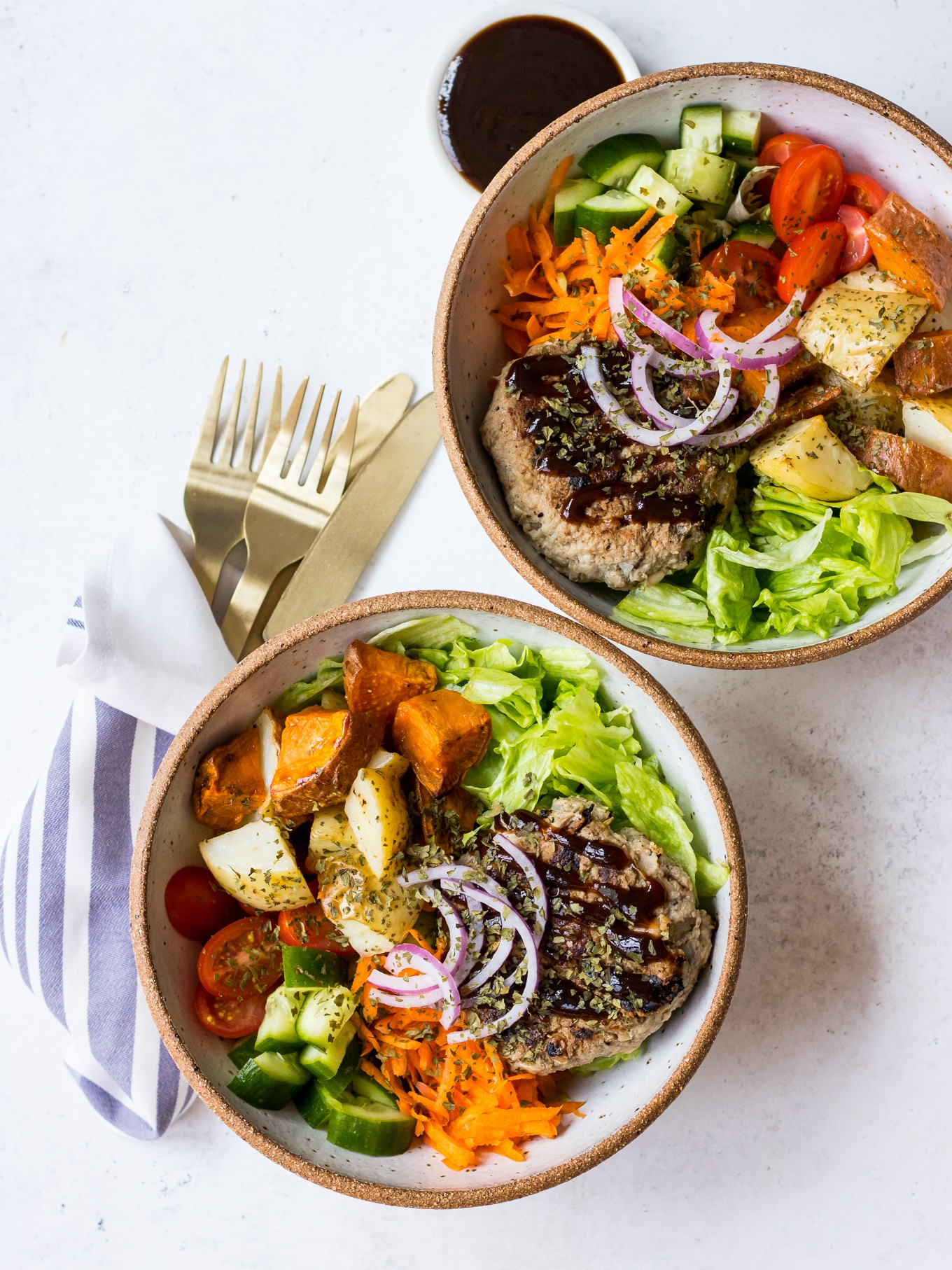 Turkey Apple Bean Burgers in ceramic bowls with salad
