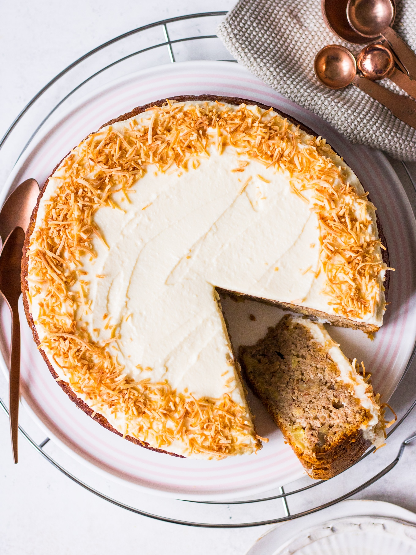 Top view of Hummingbird Cake Recipe by Nourish Every Day frosted with shredded coconut