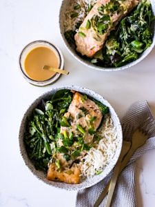 Tahini Miso Salmon in speckled white bowls with miso sauce jar