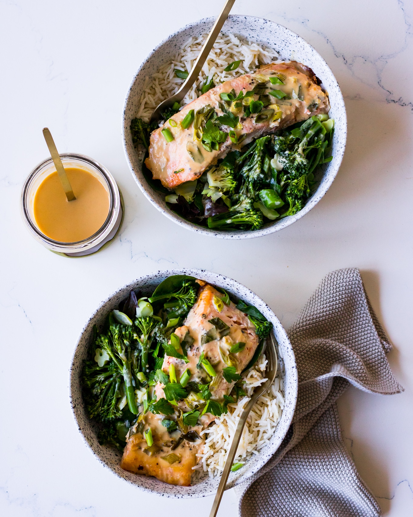Two bowls of miso salmon, white rice and greens