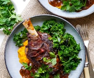 Balsamic slow cooker lamb shanks made with dried thyme and a rich flavoursome tomato sauce. Gluten free, dairy free and really easy to make! Recipe at wordpress-6440-15949-223058.cloudwaysapps.com